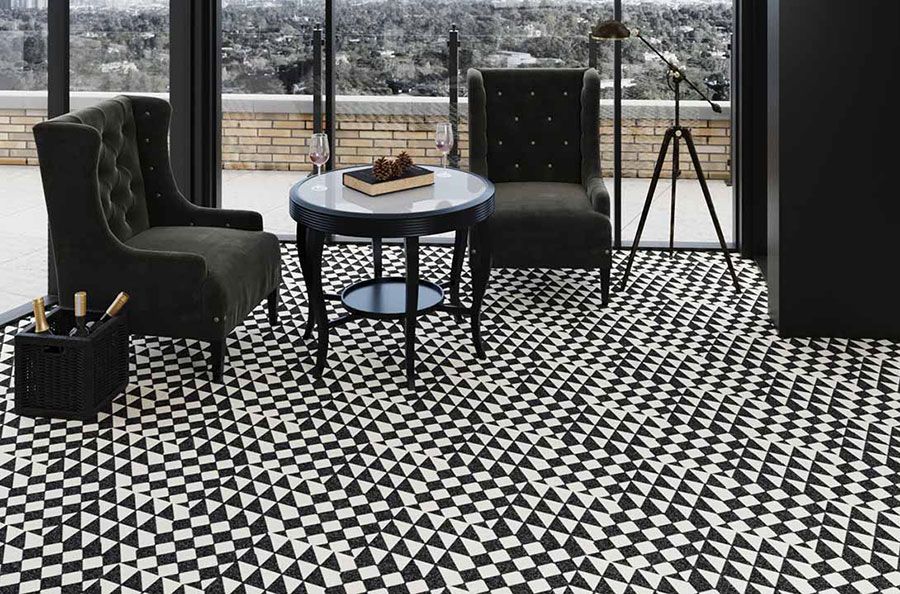 Sitting room with plush black high back chairs, white and black table, on black and white checkered tile.